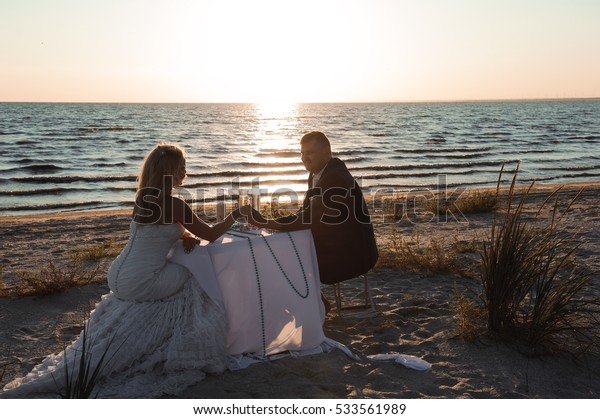 Beautiful stylish cheerful young couple in the seaside wedding day, high-quality color photos, wedding day, summer