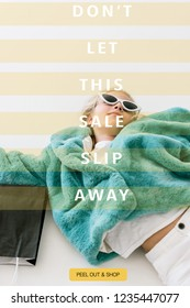 beautiful stylish child in turquoise fur coat lying with black shopping bag on white, dont let this sale slip away inscription