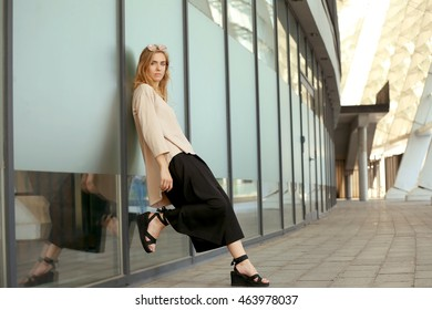 Beautiful stylish girl on street