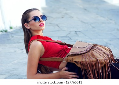 beautiful stylish girl in red blouse and sunglasses
