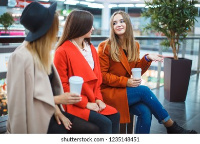 Beautiful and stylish girl sitting in the mall