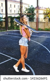 Beautiful stylish girl with skateboard - outdoor street portrait