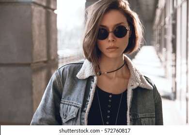 Beautiful and stylish girl in sunglasses on a sunny day