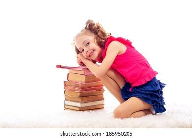beautiful stylish little girl with books. isolated on white background