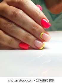 beautiful stylish nails in the style of minimalism, bright nails in yellow and orange shades of gel polish. fashionable geometry