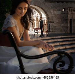 Beautiful stylish newlyweds near the old castle