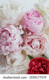 Beautiful stylish peonies bouquet close up. Pink and white peony flowers, floral greeting card and wallpaper. Happy Mothers day. Wedding bouquet