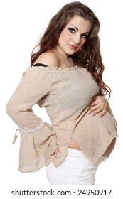 Beautiful stylish pregnant woman holding her tummy, over white background