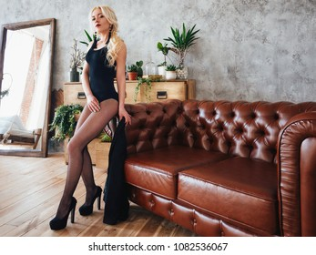 Beautiful stylish sexy blonde girl posing in the hotel's interior