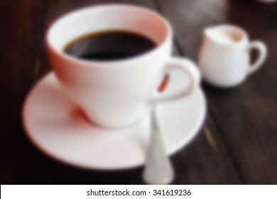 beautiful stylish stunning white cups with coffee and milk on a wooden table