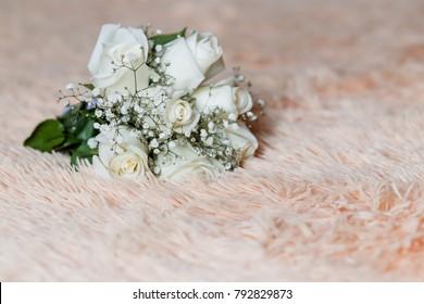 Beautiful stylish wedding bouquet of white roses