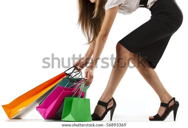 Beautiful stylish woman pulling shopping bags