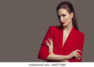 Beautiful stylish woman in red jacket. Fashion.