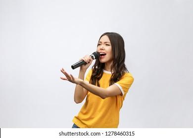 beautiful stylish woman singing karaoke isolated over white background.