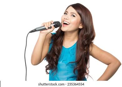 beautiful stylish woman singing karaoke isolated over white background