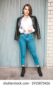 Beautiful stylish woman wearing black leather jacket. Beautiful stylish woman dressed in a black leather jacket. Fashionable and self-confident girl with short hair. Clothing, style and fashion
