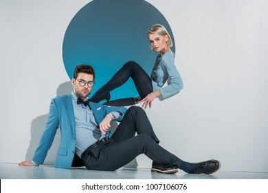 beautiful stylish young couple looking at camera in studio