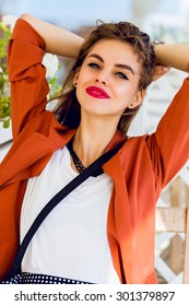 Beautiful stylish young friendship girl  sitting in summer restaurant  smiling  and  looking at camera .  Happy sunny summer vacation mood, bright colors. Have full red lips and big blue eyes.