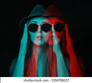 Beautiful stylish young woman in glasses and hat. Image with 3d, stereo anaglyph effect.