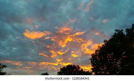 Beautiful subset rays coloring the clouds golden, North Carolina, US