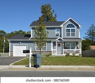 Beautiful Suburban Home Curbside Mailbox Trash Container, Clear Blue Sky Day Sunny Residential Neighborhood USA
