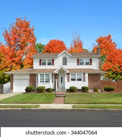 Beautiful Suburban Home residential neighborhood Autumn Season Day Blue Sky