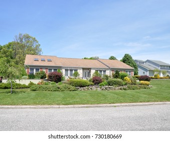 Beautiful Suburban Ranch style home blue sky clouds USA