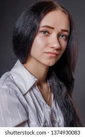 Beautiful successful young woman studio portrait.