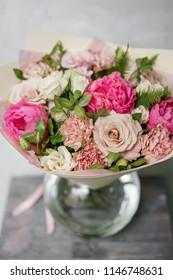 beautiful summer bouquet. flower arrangement with peonies. Color light pink. The concept of a flower shop.