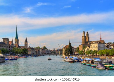 Beautiful summer cityscape of Zurich, Switzerland, at the river Limmat with the Fraumünster, Grossmünster and St. Peter Churches on the skyline