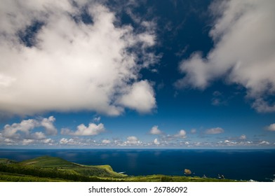 Beautiful summer clouds over Atlantic ocean. It gives a feeling that sky never ends.