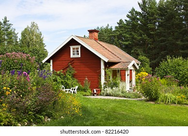 Beautiful summer cottage with flower in the garden.
