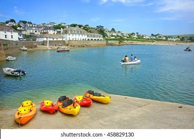 A beautiful summer day at St Mawes with holiday makers enjoying the Cornish resort on the Roseland Peninsula, near Falmouth, Cornwall, England, UK