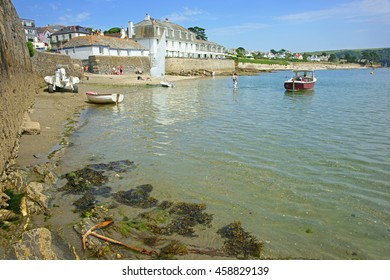 A beautiful summer day at St Mawes with holiday makers enjoying the Cornish resort on the Roseland Peninsula, near Falmouth, Cornwall, England, UK