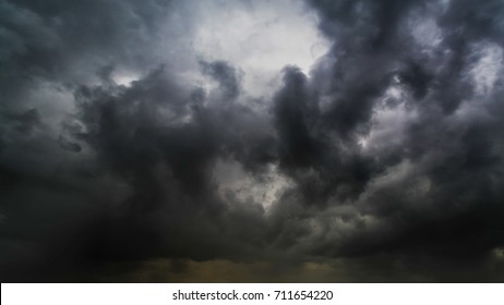 Beautiful summer day storm cloud with sun shining. Dramatic thunderstorm cloudscape with large, building clouds, natural rainy dark sky, perfect for posters background.