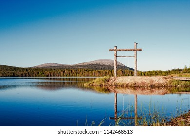 A beautiful summer evening by a quiet lake in the Finnish Lapland. The place is Yllas and it's quite popular in the wintertime.