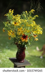 beautiful summer flowers bouquet in a glass vase outdoors