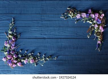 beautiful summer flowers on dark blue wooden background