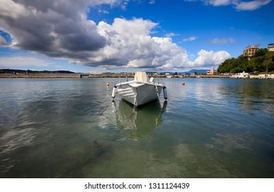 Beautiful summer landscape. Boat off the coast of Corfu island in Greece