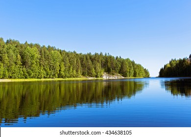 Beautiful summer landscape with forest, lake