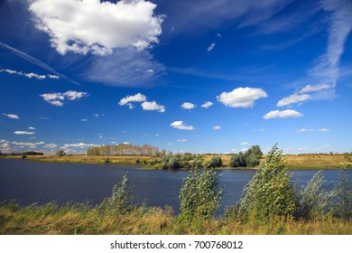 Beautiful summer landscape with lake and birches