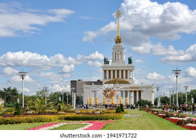Beautiful summer landscape of the Main Alley of VDNKh in the background of amazing Friendship of the People fountain with gilded sculptures and the Central Pavilion .  MOSCOW, RUSSIA - Jul 07, 2019