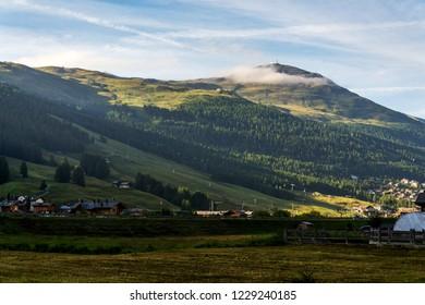 Beautiful summer landscape with Monte della Neve mountain peak over Livigno, Italy, sunrise on summer day