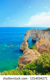 Beautiful summer landscape of portuguese coast in Algarve region, close to city Lagoa. This part of Portugal offers amazing sea caves and cliffs in picturesque bays of the Atlantic Ocean.