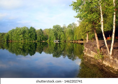 Beautiful summer landscape in a state park. Scenic view from hiking trail around the artificial lake at the Harrington Beach State Park, Wisconsin, USA. Wisconsin nature background.