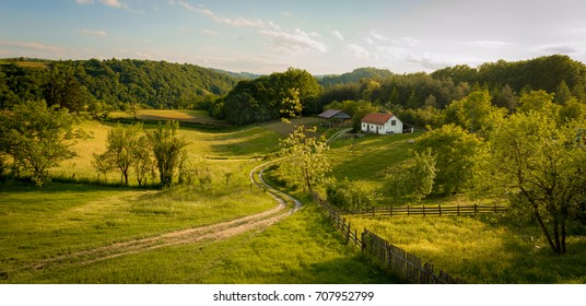 Beautiful summer landscape at sunset. Village near town of Valjevo, western Serbia.