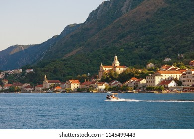 Beautiful summer Mediterranean landscape. Montenegro, Bay of Kotor, Adriatic Sea. View of ancient town of Prcanj and Birth of Our Lady church