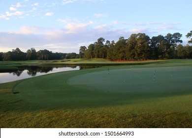 Beautiful summer morning landscape with southern golf course.  Scenic view with green grass lawn covered by morning dew during sunrise. True Blue, Pawleys Island, South Carolina, USA.