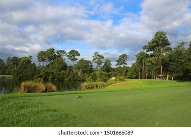 Beautiful summer morning landscape with southern golf course.  Scenic morning cloudscape with cloudy blue sky over green grass lawn and pond. True Blue, Pawleys Island, South Carolina, USA.