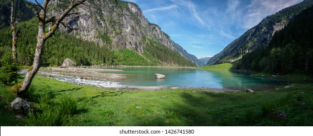 Beautiful summer morning at the Stillup reservoir in the Zillertal in Tyrol